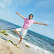 Young man standing carefree with outstretched arms