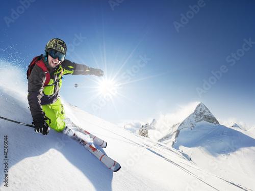 Foto-Stoff bedruckt - Skier in mountains, prepared piste and sunny day (von dell)