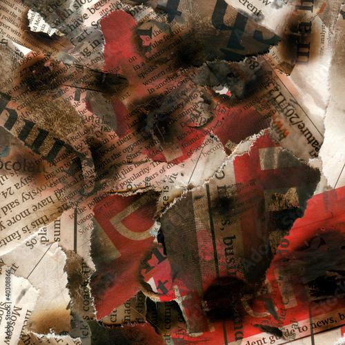 Fotobehang Kranten Broken burnt newspaper