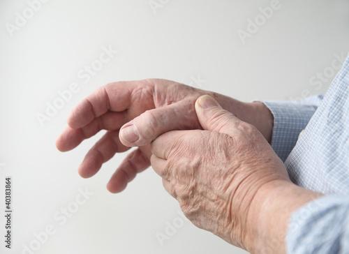 a man has pain in his thumb Wallpaper Mural