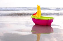 Plastic Toy Boat On A Beach Sand