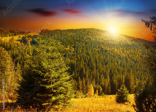 Deurstickers Oranje eclat Colorful sunset at forests mountains