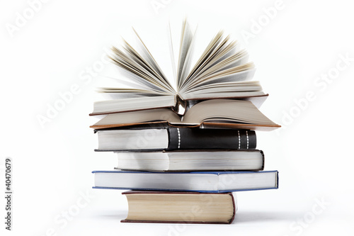 Foto-Rollo - A stack of books on a white background. (von trotzolga)