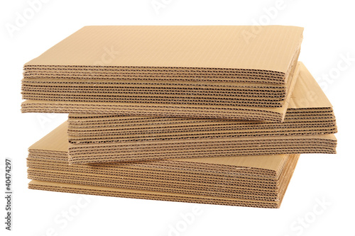 Foto  Stack Of Corrugated Board Isolated On White Background