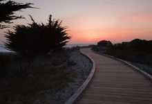 Sunset Over A Walkway Through ...