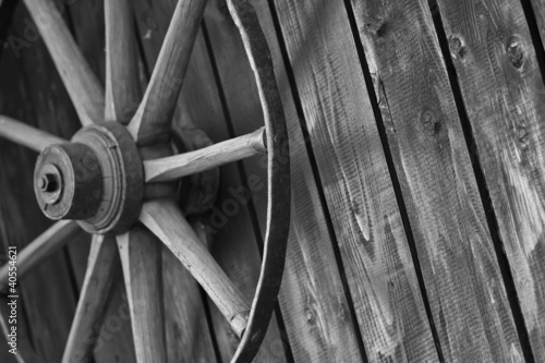 Old cart wheel against wall #40554621