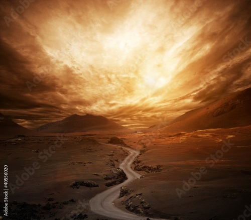 Dramatic sky over road in a valley. - fototapety na wymiar