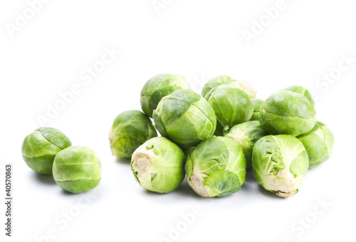 Poster Brussel Fresh green Brussels sprouts isolated on white