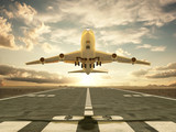 Airplane taking off at sunset - 40609892