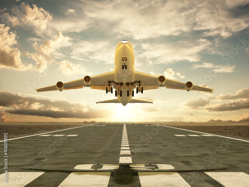 Fotografie, Tablou  Airplane taking off at sunset