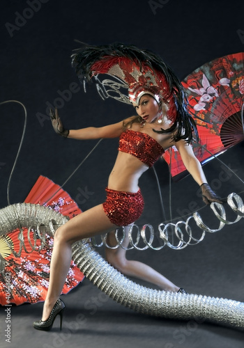 Photo  Las Vegas Dancer posing at futuristic background on club stage