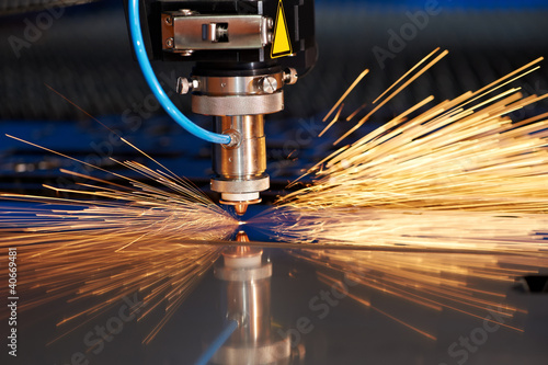 Poster Metal Laser cutting of metal sheet with sparks