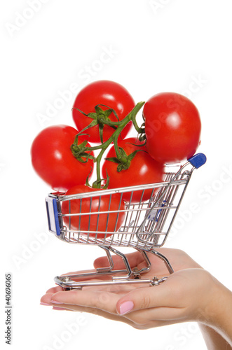 Keuken foto achterwand branch with tomatoes in shopping trolley on palm