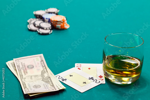 Fotografie, Obraz  a glass of liquor and cards and dollars