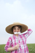 little girl with summer hat in meadow