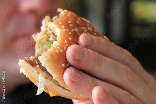 Man enjoying his hamburger