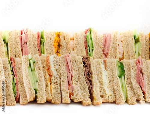 Foto op Canvas Snack A Platter of Triangular Sandwiches