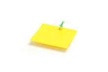 Yellow Reminder Note With Green Pin Isolated On The White