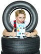 Apprentice shows thumb up for tire label on white backround