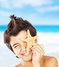 Happy Face Boy With Starfish On The Beach