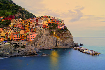 Fototapeta Manarola, Italy on the Cinque Terre coast at sunset