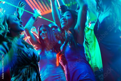 Fotografie, Obraz  Party people dancing in disco or club