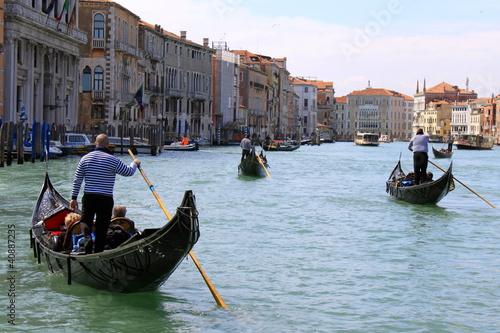 Spoed Foto op Canvas Gondolas Balade en gondoles dans le Grand Canal de Venise - Italie