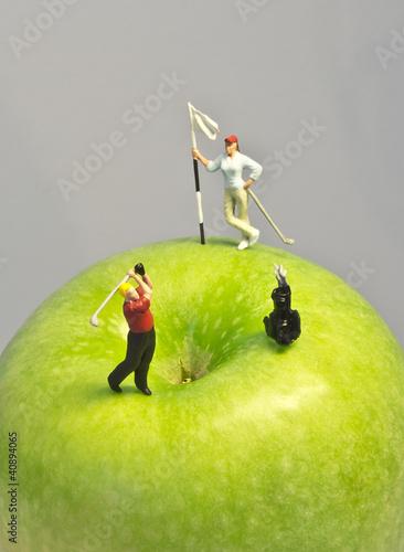 Fotografie, Obraz  Miniature golf on apple