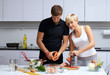 couple in their kitchen making dinner