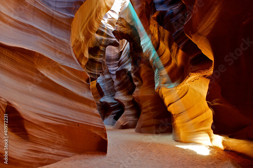 Colorful sun beam shining in Antelope Canyon.