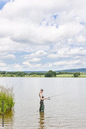 Printed kitchen splashbacks Fishing woman fishing in pond