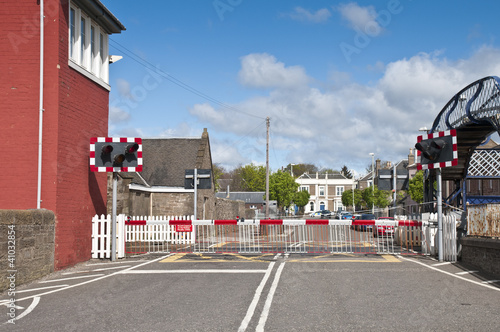Valokuva Level crossing at railway with gate down