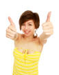 A woman with a thumbs up sign, isolated on white background