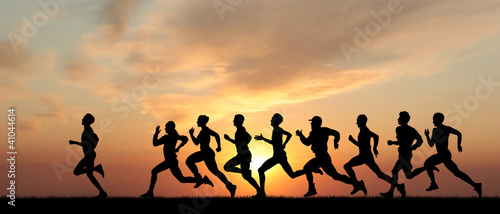 Photo Marathon, black silhouettes of runners on the sunset