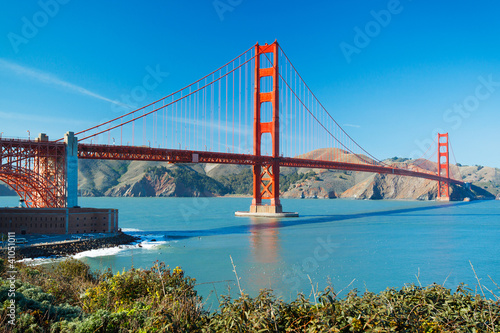 The Golden Gate Bridge in San Francisco with beautiful blue ocea Poster