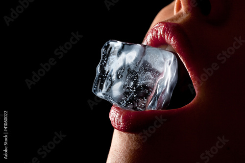 Fototapeta Ice cube in woman's mouth. obraz