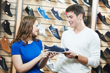 Man And Assistant At Shoe Shop...