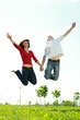 Photo of a happy couple in a jump
