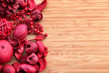 Red Potpourri On Wood With Copy Space