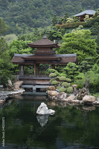 Pond and garden of Chinese Temple in Hong Kong Poster
