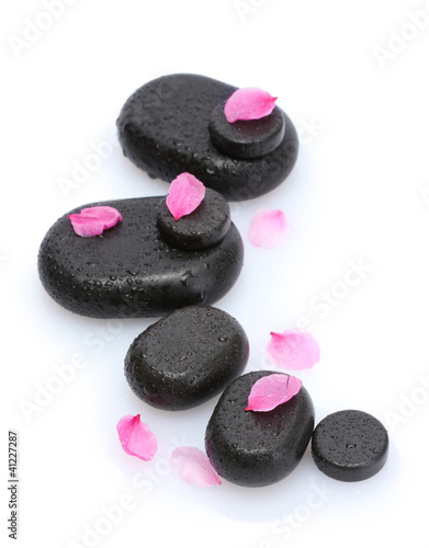 Fotografering  Spa stones with drops and pink petals isolated on white.