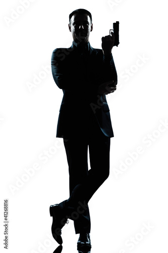 Stampa su Tela silhouette man full length secret agent in a james bond posture