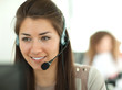 canvas print picture - Female customer support operator with headset and smiling