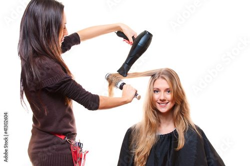 studio shot of hairdresser with hairdryer