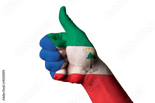 Fotografía  equatorial guinea national flag thumb up gesture for excellence