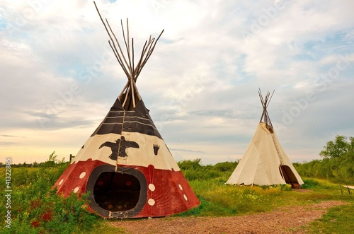 Fotobehang Indiërs image of an aboriginal tee-pee at sunset in the summer