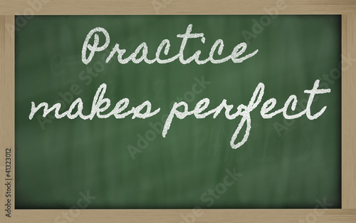Fotografía  expression -  Practice makes perfect - written on a school black