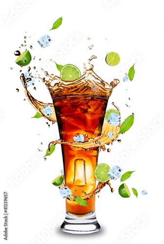 Photo Stands Splashing water Fresh cola drink with limes. Isolated on white background