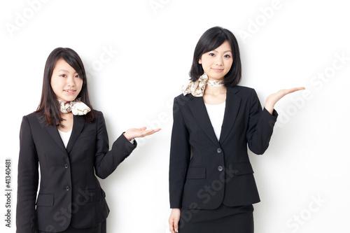 Fotografía  asian businesswomen showing