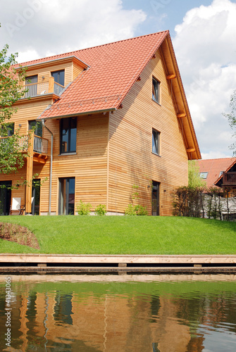 Haus Mit Holzfassade Am Wasser Buy This Stock Photo And Explore